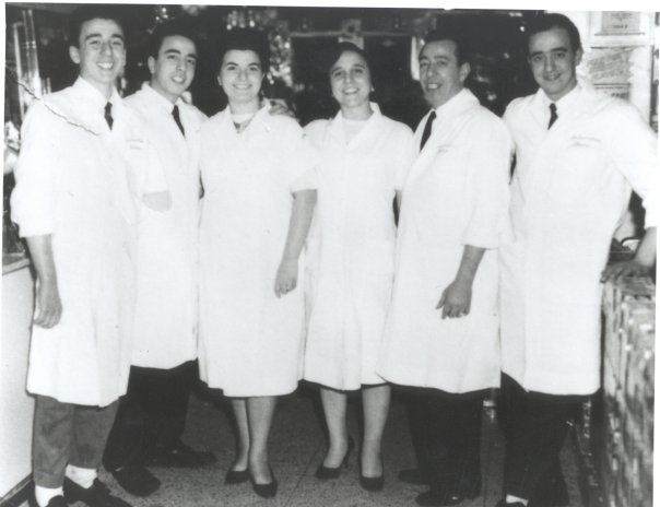 The Sbarro family dressed in white inside of the original NY location